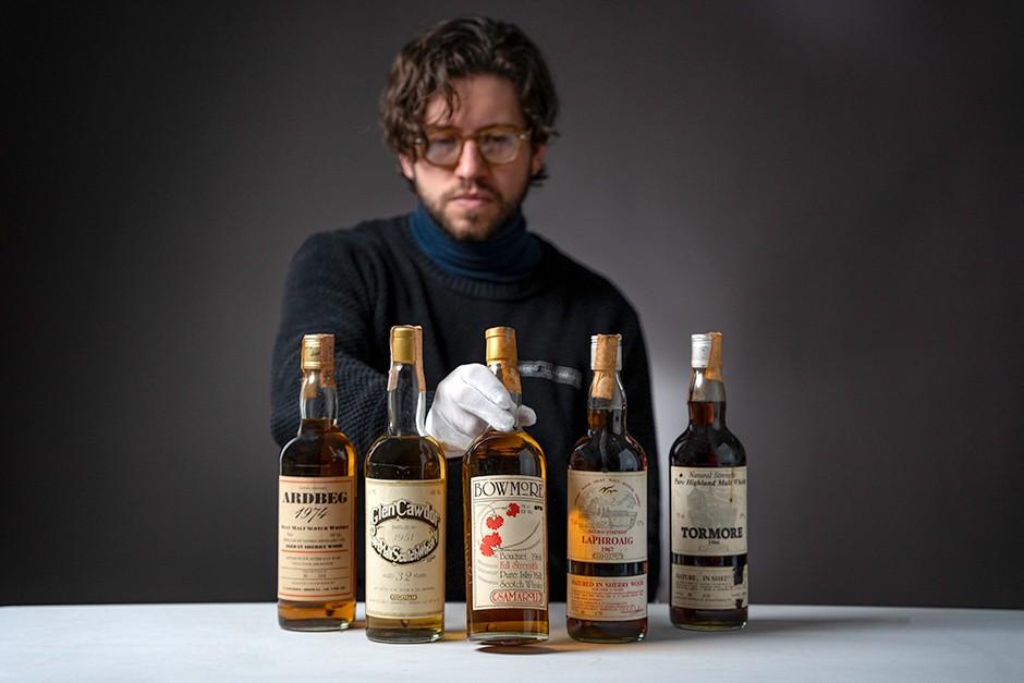 Joe Wilson, Whisky Auctioneer with Emmanuel Dron's Collection of Signed Samaroli Bottles
